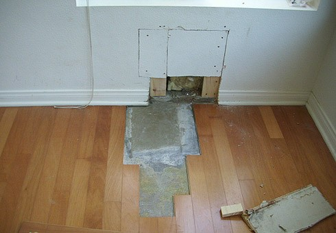 BEFORE: Floor and Wall Damaged by Pipe Leak