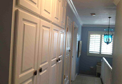 AFTER: Custom Cabinet Doors & Banister Painting